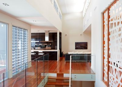 Floor to ceiling Breezway louvres provide endless views
