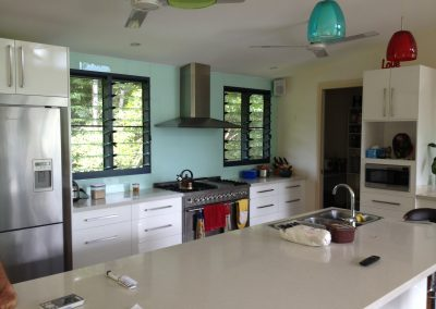 Large louvre windows in the kitchen keep this working space cool and fresh