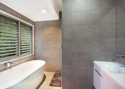 Breezway Louvre Windows in the bathroom with silkscreen glass for privacy